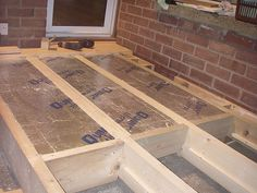 insulation for sub floor. May put copper pipes under plywood to act as floor heating. Joists are at wall supported in the middle, then and and then to cope with the ground slope from the wall. Floor Insulation, Eco Buildings, Garage Renovation, Home Upgrades, Building A Shed, Diy Organization, Home Projects, Home Remodeling, Tile Floor