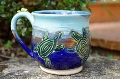 20% off of this sweet turtle mug on my Etsy (there are 2 others available as well 😊) 🐢💚 #pottery #ceramic #ceramics #potterymug #ceramicmug #turtle #turtles #coffeemug #etsy #carvedclay #handmade #wheelthrown #blue #lightblue #darkblue #forsale #florida #beach #ocean #beachy #teamug #sale #shopsmall