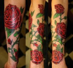 I think this would look nice with me butterfly..  Rose tattoo with thorn, leaves, and vine