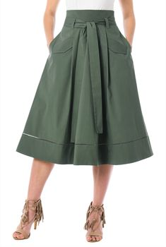 Faux flap pockets add utilitarian charm to our pleated cotton poplin skirt cut with a high banded waist and a drapey sash tie belt.