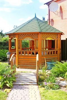 Classic wooden gazebo with green roof with small bridge leading to it - I like the Lamp post near the entrance