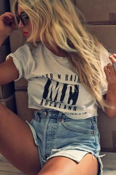 cut-off tee with high wasted jean shorts.
