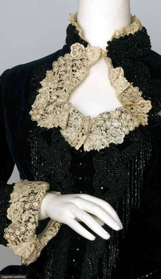 Beaded black velvet bustle dress 1880s. Augusta Auctions.