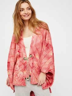 Shibori Printed Kimono | Pretty silky kimono featuring a boho-inspired shibori print and ultra wide, flowy sleeves.      * Structured hem with side vents    * Faux slit pockets    * Front rope ties    * Lined