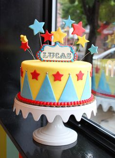This fun circus birthday cake features a custom name topper and colorful big top details! By Whipped Bakeshop in Philadelphia. Carnival Birthday Cakes, Dumbo Birthday Party, Circus First Birthday, Circus 1st Birthdays, Carnival Cakes, Carnival Themed Party, First Birthday Cakes, Circus Party, Circus Wedding