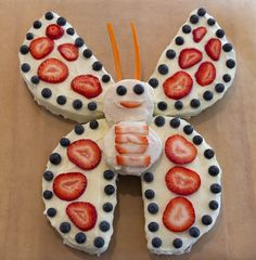 Butterfly cake for my neice, Irie's first birthday party, decorated by Sara Webb  http://logcabincooking.com/
