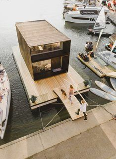 This Tiny House Can Be Built in One Day—And it Floats on WaterIt's definitely not your average house boat. It's definitely not your average house boat. Prefab Cabins, Prefab Homes, Modern Tiny House, Tiny House Design, Tiny House Movement, Zinc Cladding, Modular Housing, Salons Cosy, Cabin In The Woods