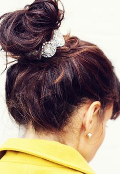 Three Ways to Dress Up Your Top Knot Bun...super cute! Remember scrunchies? This rhinestone wrap is basic rhinestone bridal trim attached to a piece of stretch elastic. Pre-measure your rhinestone trim to wrap 3/4 of the way around your top knot. Just hot glue a couple inches of your elastic piece to either end of your rhinestone trim and let dry.