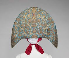 Headdress    Date:      early 19th century  Culture:      Russian  Medium:      silk, glass, semi-precious stones, metal, cotton, mother-of-pearl  Dimensions:      7 x 41 in. (17.8 x 104.1 cm)  Credit Line:      Brooklyn Museum Costume Collection at The Metropolitan Museum of Art, Gift of the Brooklyn Museum, 2009; Gift of Mrs. Edward S. Harkness in memory of her mother, Elizabeth Greenman Stillman, 1931  Accession Number:      2009.300.1101