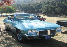 1970 1/2 Pontiac T-37 Tempest. My mother bought a new one - pallisade green with a dark green vinyl top, 350 V8.  GREAT car!