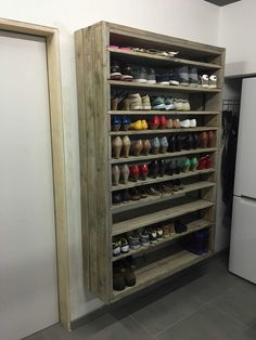 Shoe rack from pallets and planks, roughly sanded, brushed and gray wash.