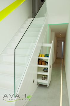 Minimalist White Wooden Graded Rack With Sliding Door Under White Wooden Stairs With Glases Divider For Best Under Stairs Storage Ideas