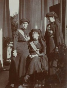 A slightly different version of this famous photograph of the Grand Duchesses Marie, Olga and Tatiana, in mourning clothes for the Grand Duke Konstantine who died just prior to the revolution. Anastasia and Alexei were deemed to young to attend the funeral,