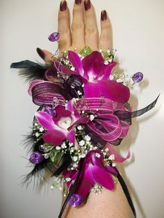 wristlet corsage with magenta orchids