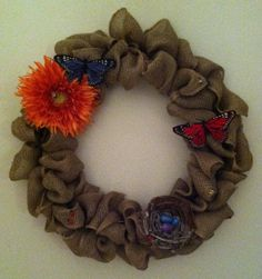 This whimsical wreath celebrates the arrival of spring.  Zoom in and see the lady bugs and bumble bees.