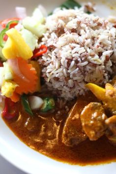 Malaysian Food - Nasi Dagang: a heady rich meal with mixed grain rice cooked in coconut milk and fenugreek, ginger and shallots; a side of pickled veg (cucumber, carrot, pineapple) and eaten with a tuna curry called gulai ikan aya.
