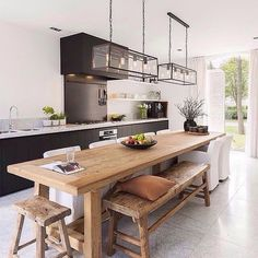 We love the idea of having a long bench as a dining table as opposed to individual chairs.