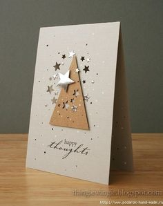 What a simple sparkly card! A tree shape cut from kraft paper, with some small stars punched out of it, really pops on this white card. Silver and gold stickers or punches add the holiday spirit to this handmade Christmas card. Homemade Christmas Cards, Homemade Cards, Handmade Christmas, Simple Christmas, Christmas Stickers, Xmas Cards, Holiday Cards, Cards Diy, Gift Cards