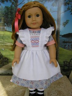 Pinafore from a Primrose Lane pattern.  Check out the smocked insert with the lace trim...too, too special!