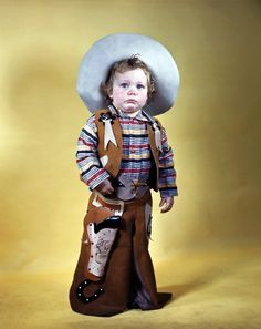 The long face only adds to the complexity and thoughtfulness of his cowboy costume.