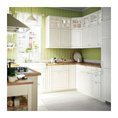 Ikea kitchen with BODBYN off-white drawer fronts, doors and glass doors. Note: Ikea is changing its kitchen cupboard system over the next year or two, country by country. Ikea Bodbyn Kitchen, Ikea Kitchen Cabinets, Kitchen Appliances, Kitchen Units, White Cabinets, Glass Cabinets, Green Kitchen, New Kitchen, Kitchen Cook