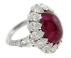 Classical - 1st Place  James Currens, J.W. Currens, Inc. - Platinum ring featuring a 14.25 ct. unheated Ruby cabochon accented with Diamonds (7.97 ctw.).