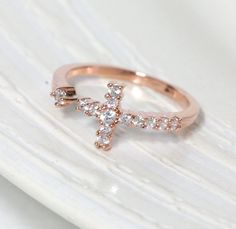 Sideways cross ring in pink gold , adjustable... Want this sooooo very badly! Who wants to get me it ;)