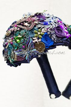 Mad Hatter Wedding Theme Bouquet Bestseller Alice in Wonderland Wedding Brooch Bouquet is full of characters from Lewis Carroll fairytale book.