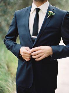 Groomsmen style- black suit and black textured tie. Tie clip as gift