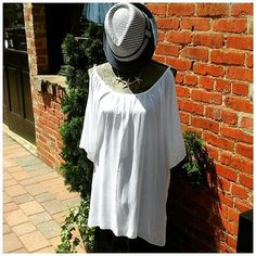 Style & comfort come together at DMC DESIGN. Our pick for an afternoon outing in this glorious weather? This fresh white cold shoulder tunic out of breeze catching gauze that is universally flattering! Pair with dark slim fit jeans and kick it up a style notch with this navy & white fedora and gold starfish necklace. #enjoyshoppingagain #buylocal_wakeforest #summerfashion #accessories #dmcdesignco