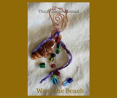Beach Totem — A wire wrapped foot with Magpie Treasures