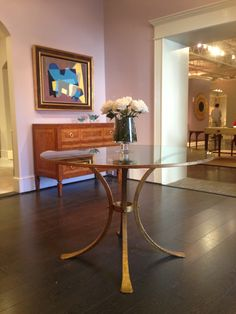 Modern History - Retro Guilded Table - Wrought iron finished in gold leaf with glass top with gold leafed edge around the glass. True artisan statement piece. Simple elegance. #hpmkt #stylespotters #gold #glass #entry #table #design #HighPoint #modern #history #art #style  430 N Wrenn