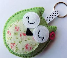 These cute owl keyrings are handstitched by me in a gorgeous corner of Devon, England. Each is made with felt and has a contrast fabric circle