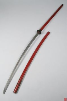 "Nagamaki.The nagamaki (長巻?, literally ""long wrapping"") is a type of traditionally made Japanese sword (nihonto) with an extra long handle, used by the samurai class of feudal Japan."