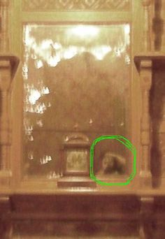 The circled anomaly is a reflection caught in the mirror at the Winchester House in CA. It was not there when the photo was taken.
