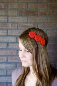 i own three of these triple rosette headbands. so beautiful.
