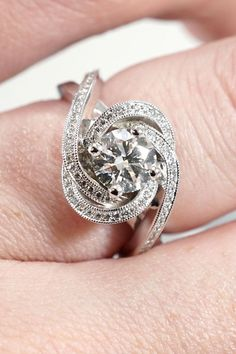 This exquisite engagement ring features a round Star 129 diamond prong set in the center of a swirling halo of bright cut set diamonds, with additional diamond and milgrain accents on the split, criss-cross shank. Designed and created by Joseph Jewelry | Seattle, WA | Bellevue, WA | Online | Design Your Own Engagement Ring | #engagementring