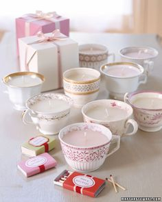 Tea cup candles as a gift at a tea party - cups from thrift store