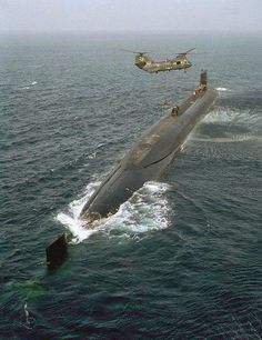 "Submarine US Navy.I could put this in ""The Nav"" but figured I'd go here.there's nothing like an Unrep / Vertrep at sea, especially sub style, with a helo. Navy Marine, Navy Military, Cruisers, Us Navy Submarines, Nuclear Submarine, Go Navy, Us Navy Ships, Military Weapons, Boat Plans"