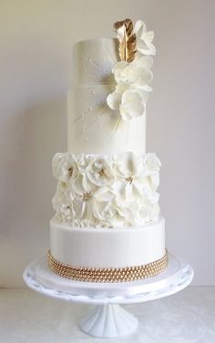 Elegant tiered ivory cake with a touch of gold glam #weddings #cakes