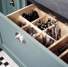 Upright cutlery drawer... Doesnt look messy... More storage in a smaller space.. Just wondering if this will b more diff to clean...shud have removable insers..