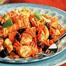 Red Sauce Chicken and Pasta - This recipe for sautéed chicken chunks in a spicy mole sauce, which features a hint of chocolate, tossed with fusilli pasta was developed at the Texas Culinary Academy.
