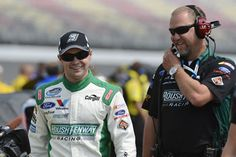Ricky Stenhouse Jr. and Mike Kelly have a laugh before the start of the race at Michigan.