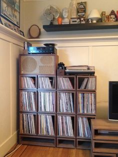 Really beautiful custom record storage in Walnut(? Thanks Joel Rouse. Record Home, Record Shelf, Vinyl Record Storage, Storage Design, Storage Shelves, Cabinet Under Stairs, Vinyl Cd, Vinyl Records, Stereo Cabinet