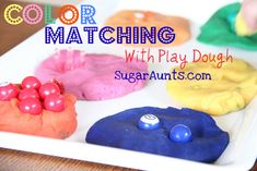 Matching beads, paper clips, etc with play dough. Swish items in bucket of water afterwards.