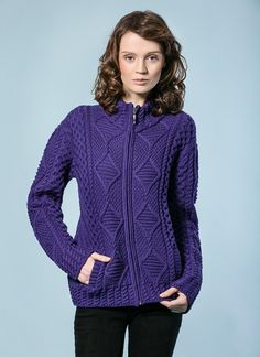 Megan Zip Aran - Our Megan Zip Aran sweater for women has been knit with 100% Merino Wool and features a stunning display of many time honoured Aran stitches such as cable, moss and diamond. These indicate symbols of good luck, success and wealth.