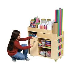 Features:  -Top tray with deep sides.  -Pull out drawer with ball-bearing casters.  -Center storage compartment with doors and ample space.  Product Type: -Classroom cabinet.  Toddler Size: -Yes.  Cas