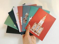 Little Histories aims to tell you the story behind the architecture that surrounds us. Each card is carefully illustrated to show you the beauty of a building and tell the story of where it is, what it is, and what it has been. These cards are perfect to collect and share with your friends, family, and acquaintances that you kind of like (because everyone deserves a nice card now and then.) Product Specifications: - 8 Folded A2 (4.25 x 5.5) Greeting Cards - Blank Interior - Includes…