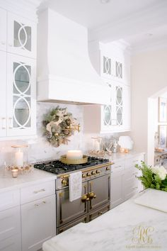 Christmas Home Tour 2017 - Silver and Gold Christmas in a white transitional kitchen with a La Cornue range- Randi Garrett Design