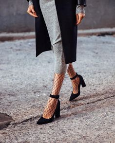 Fishnets paired with a midi dress offer a conservative, lady-like way to rock this sexy trend. WorkingLook.com